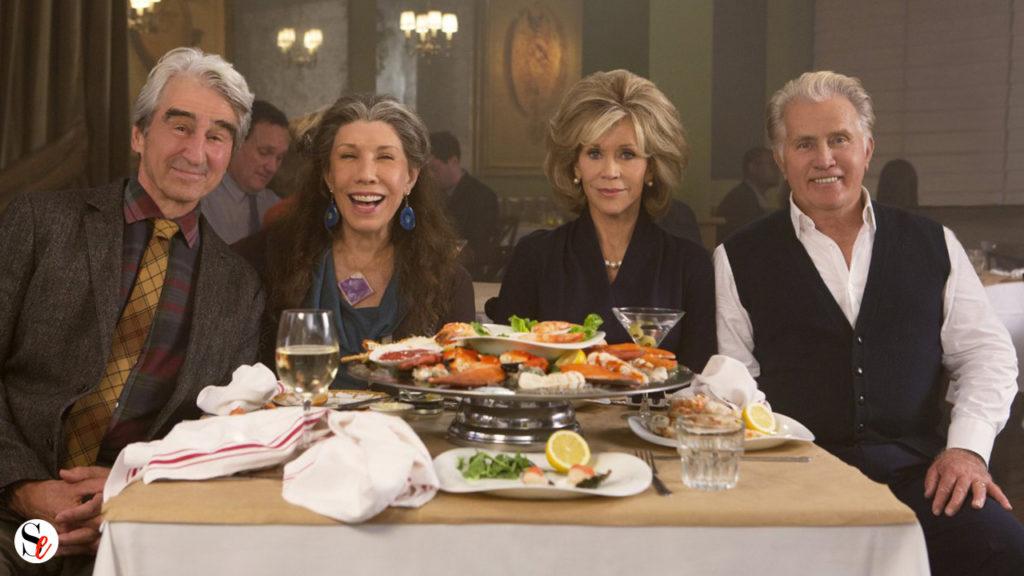 Sol, Frankie, Grace y Robert en una cena.